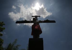 A Filipino devotee is nailed to a cross to re-enact the crucifixion of Jesus Christ in Santa Lucia village, Pampanga province, northern Philippines on Friday, April 18, 2014.