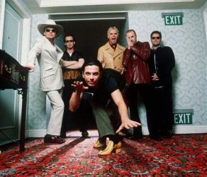 In this 1997 file photo,  members of the Australian rock band INXS pose for a group portrait at the Ritz Carleton Hotel in Aspen. Colo.