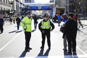 Police stand by near the finish line ahead of Monday's 118th Boston Marathon, Sunday, April 20, 2014.