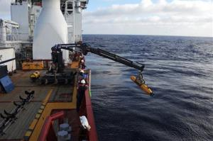 In a Monday, April 14, 2014 photo provided by the US Navy, operators aboard the Australian defense vessel Ocean Shield move the US Navy's Bluefin-21 autonomous underwater vehicle into position for deployment.