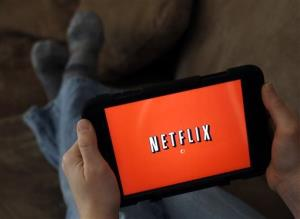 In this Friday, Jan. 17, 2014 file photo, a person displays Netflix on a tablet in North Andover, Mass.