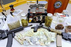 This photo shows drugs, money, guns, and other illegal items seized when Lower Merion Police broke up a drug distribution ring, during a news conference in Montgomery County, Pa, April 21, 2014.
