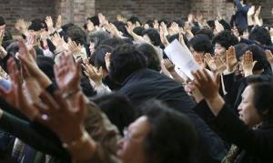Christians pray during a service for the safe return of passengers of the sunken Sewol ferry at a church in Seoul, South Korea, Tuesday, April 22, 2014.