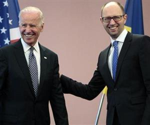 U.S. Vice President Joe Biden, left, and Ukrainian Prime Minister Arseniy Yatsenyuk smile for the cameras during a meeting in Kiev, Ukraine, April. 22, 2014.
