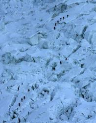In this Sunday, May 18, 2003 file photo, mountaineers pass through the treacherous Khumbu Icefall on their way to Mount Everest near Everest Base camp, Nepal.