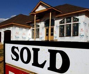 In this Aug. 22, 2011, file photo, a sold sign is posted in front of a new home in Springfield, Ill.