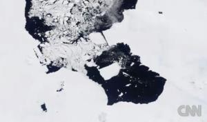 A screen shot from CNN video is centered on the giant iceberg.