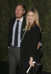 In this Jan. 14, 2014 file photo, Drew Barrymore and Will Kopelman arrive at the Chanel Dinner celebrating the release of Drew Barrymore's new book at Chanel Boutique in Beverly Hills, Calif.