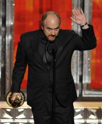 Louis C.K. accepts the award for outstanding writing in a comedy series to for Louie at the 64th Primetime Emmy Awards at the Nokia Theatre on Sunday, Sept. 23, 2012, in Los Angeles.