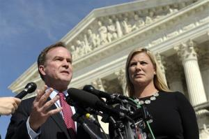 Michigan Attorney General Bill Schuette, left, standing with Jennifer Gratz, who spearheaded the affirmative action ban.