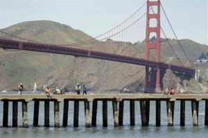 Fishermen converge on a pier near the site of a shipwreck discovery in San Francisco.