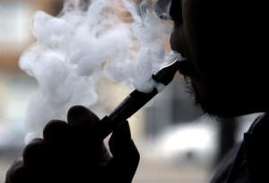 Daryl Cura demonstrates an e-cigarette at Vape store in Chicago, Wednesday, April 23, 2014.