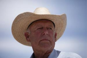 Rancher Cliven Bundy speaks at a protest area near Bunkerville, Nev., on April 16, 2014.