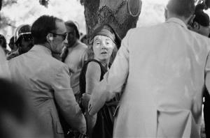 In this  Sept. 5, 1975 photo, Secret Service agents put handcuffs on Lynette Squeaky Fromme after she pointed a gun at President Gerald Ford in Sacramento, Calif.