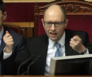Ukrainian Prime Minister Arseniy Yatsenyuk speaks to lawmakers during a session at the Ukrainian parliament in Kiev, Ukraine, Friday, April 18, 2014.