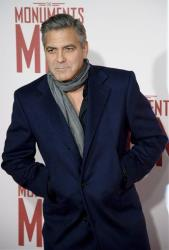 George Clooney arrives for the UK Premiere of The Monuments Men at a central London cinema, London, Tuesday, Feb. 11, 2014.