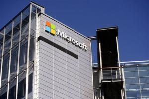 The logo of U.S. technology giant Microsoft is installed on the wall of Nokia's former headquarters in Espoo, Finland on Saturday April 26, 2014. Nokia Corp. says it continued to be hit by fierce competition in the first-quarter with a 30 percent fall in sales of mobile devices, the...