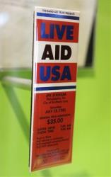 A 1985 Live Aid ticket for JFK stadium in Philadelphia is displayed at the Rock and Roll Hall of Fame and Museum.