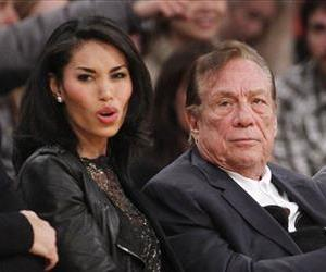 Los Angeles Clippers owner Donald Sterling and V. Stiviano, left, watch the Clippers play the Los Angeles Lakers in this file photo.