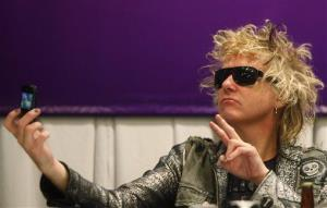 Scorpions drummer James Kottak takes a selfie during a press conference.