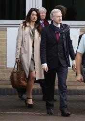 In this Thursday, Nov 24, 2011 file photo, lawyer Amal Alamuddin, left, is seen walking alongside WikiLeaks founder Julian Assange as they leave Belmarsh Magistrates Court in southeast London.