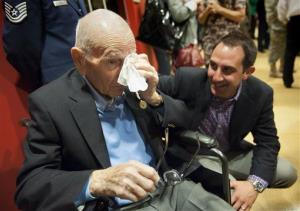 Former Wauvilermoos prison camp POW, retired Air Force Major James Moran, wipes following a ceremony where Moran was presented with the Prisoner of War Medal, Wednesday, April 30, 2014.