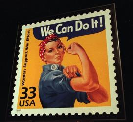 A June 25, 1999, file photo shows an enlargement of the U.S. Postal Service's stamp depicting Rosie the Riveter.
