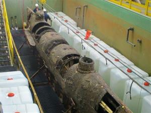 The Confederate submarine HL Hunley sits in a conservation tank at a lab in North Charleston, SC.