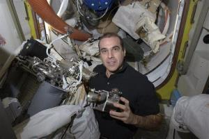 In this NASA file photo, astronaut Rick Mastracchio works to replace a pump in a spacesuit aboard the International Space Station.