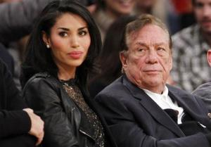Los Angeles Clippers owner Donald Sterling, right, and V. Stiviano, watch the Clippers play in 2010.