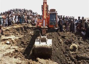 Afghans search for survivors after Friday's landslide buried Abi-Barik village in Badakhshan province.
