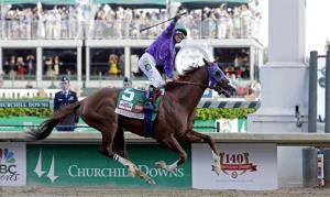 Victor Espinoza rides California Chrome to victory.