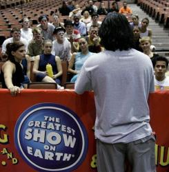 Members of Ringling Bros. and Barnum and Bailey Circus listen during a break in rehearsals for the Greatest Show on Earth Dec. 11, 2007.