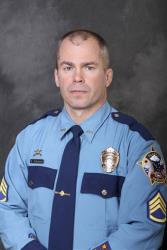 This undated photo released by the Department of Public Safety shows Sgt. Patrick Scott Johnson.