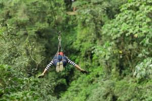 A stock image of a woman on a zip line.