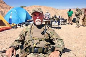 This Wednesday, April 16, 2014 photo shows Jerry DeLemus, of Rochester, N.H., talks, about heading a group of self-described militia members who have been camping on rancher Cliven Bundy's ranch near Bunkerville, Nev. Armed  backers of embattled rancher Cliven Bundy are still living along a state highway in southern...