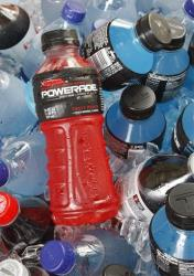 In this Aug. 5, 2010 file photo, bottles of Powerade sports drink and other Coca-Cola products are chilled over ice in Orlando, Fla.