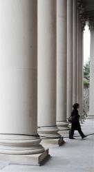 In this 2009 file photo, a woman enters the Widener Library at Harvard University in Cambridge, Mass.
