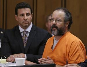 Ariel Castro, right, speaks during the sentencing phase as defense attorney Craig Weintraub watches Thursday, Aug. 1, 2013, in Cleveland.  Castro was sentenced to life in prison plus 1,000 years.
