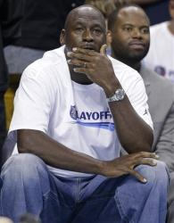 Charlotte Bobcats owner Michael Jordan watches the first half in Game 4 of the Bobcats' opening-round NBA basketball playoff series against the Miami Heat in Charlotte, NC, Monday, April 28, 2014.