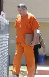 Bernie Tiede is led into the Panola County court house by law enforcement officials in Carthage, Texas, Tuesday, May 6, 2014.