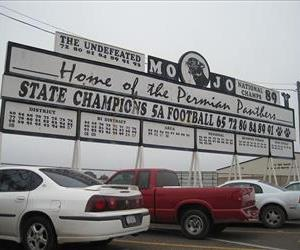 A sign celebrating Permian High School's football team.