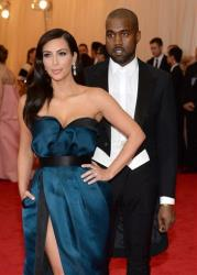 Kim Kardashian, left, and Kanye West attend The Metropolitan Museum of Art's Costume Institute benefit gala celebrating Charles James: Beyond Fashion on Monday, May 5, 2014, in New York.
