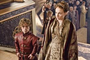 This publicity image released by HBO shows Peter Dinklage, left, and Sophie Turner in a scene from Game of Thrones.