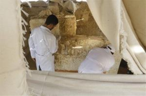 Egyptian conservators work at the site of a newly discovered tomb dating back to around 1100 B.C