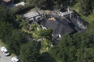 This aerial photo shows the burned out home on Thursday, May 8, 2014 in Tampa, Fla.