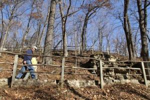 In this Nov. 8, 2010 file photo, hikers walk one of the trails at Effigy Mounds National Monument in Harpers Ferry, Iowa.
