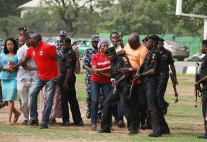 Police officers try to block a protester during a rally in Abuja, Nigeria yesterday.