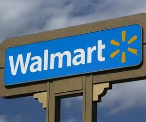In this  May 28, 2013, file photo, an outdoors sign for Walmart is seen in Duarte, Calif.