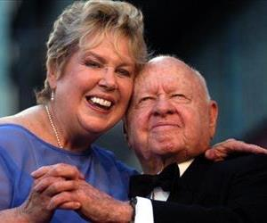 In this Monday, April 26, 2004, file photo, Jan, left, and Mickey Rooney pose for photographs after having unveiled their star on the Hollywood Walk of Fame in Los Angeles.